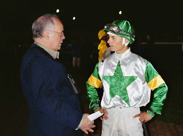 The owner and breeder Luiz Eduardo Lages giving the last instructions for the champion-jockey Per Gråberg in the paddock of Täby Galopp in Stockholm, Sweden, before the race AMARILDO started. This photo is from 28 September 2004