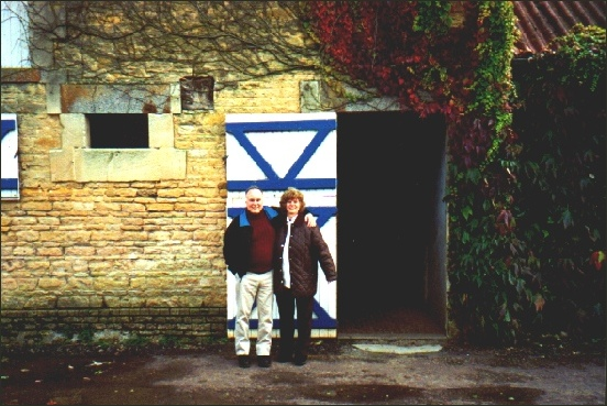 Mr. Luiz Eduardo Lages and Mrs. Iréne Lages in front of a beautiful old stable in Normandy, France